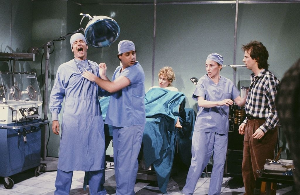 Tom Hanks as doctor, Jon Lovitz as doctor, Victoria Jackson as mother, Dana Carvey as father during the 'Delivery Room' skit