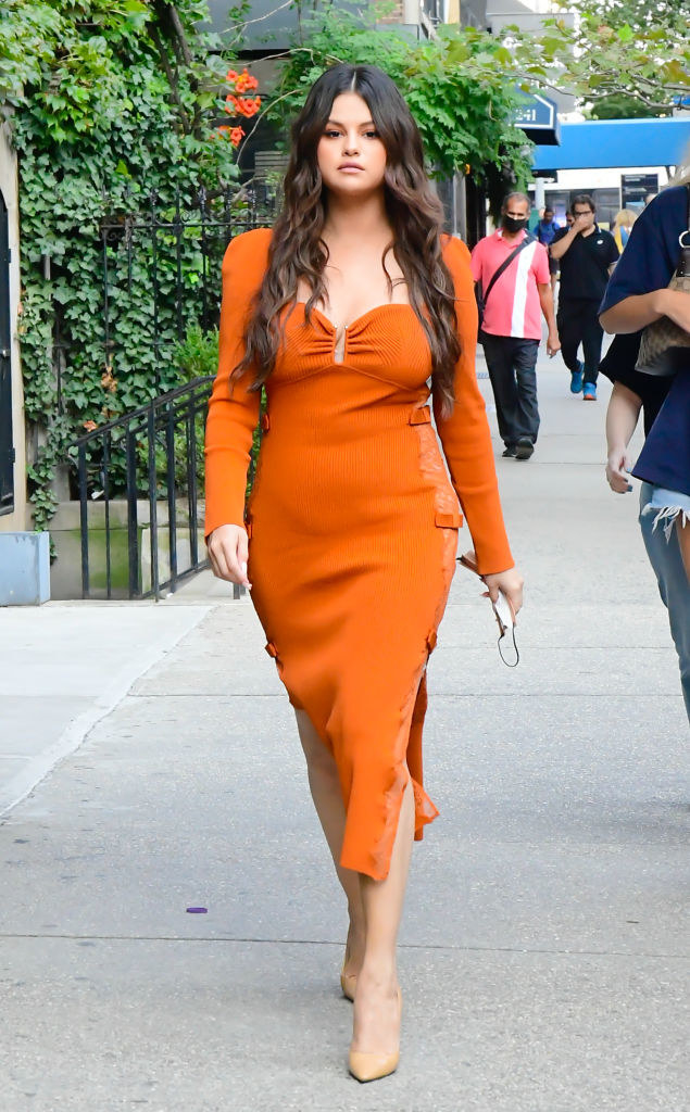 Selena Gomez walking in Soho in a brightly colored dress