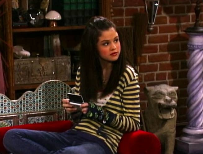 Selena wearing a striped long-sleeved shirt and jeans