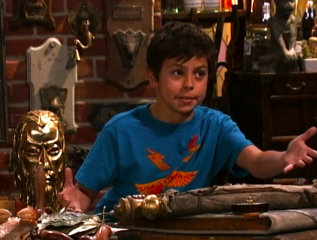 Jake T. Austin as Max Russo in a graphic t-shirt