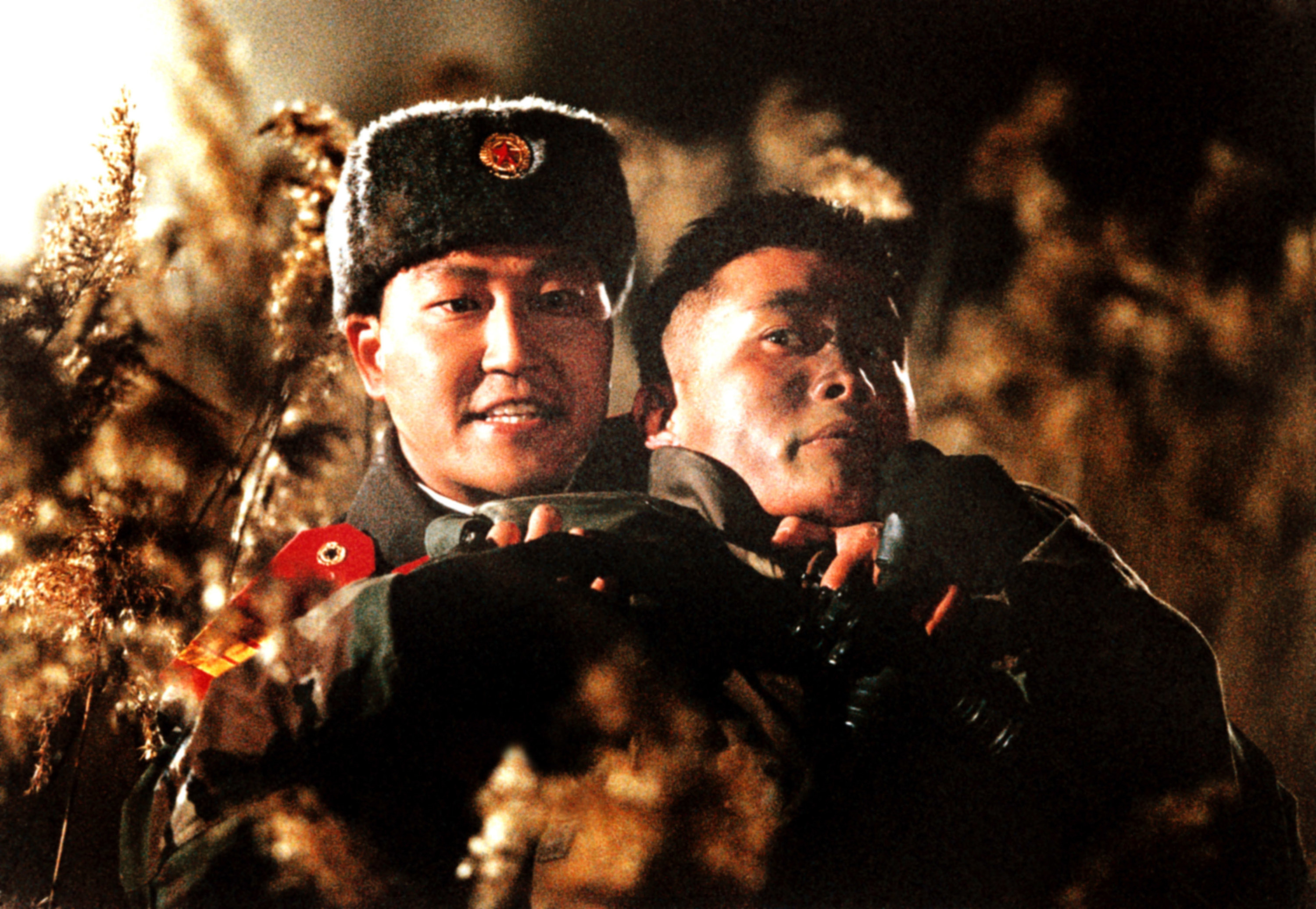 A North Korean soldier holds a South Korean soldier hostage