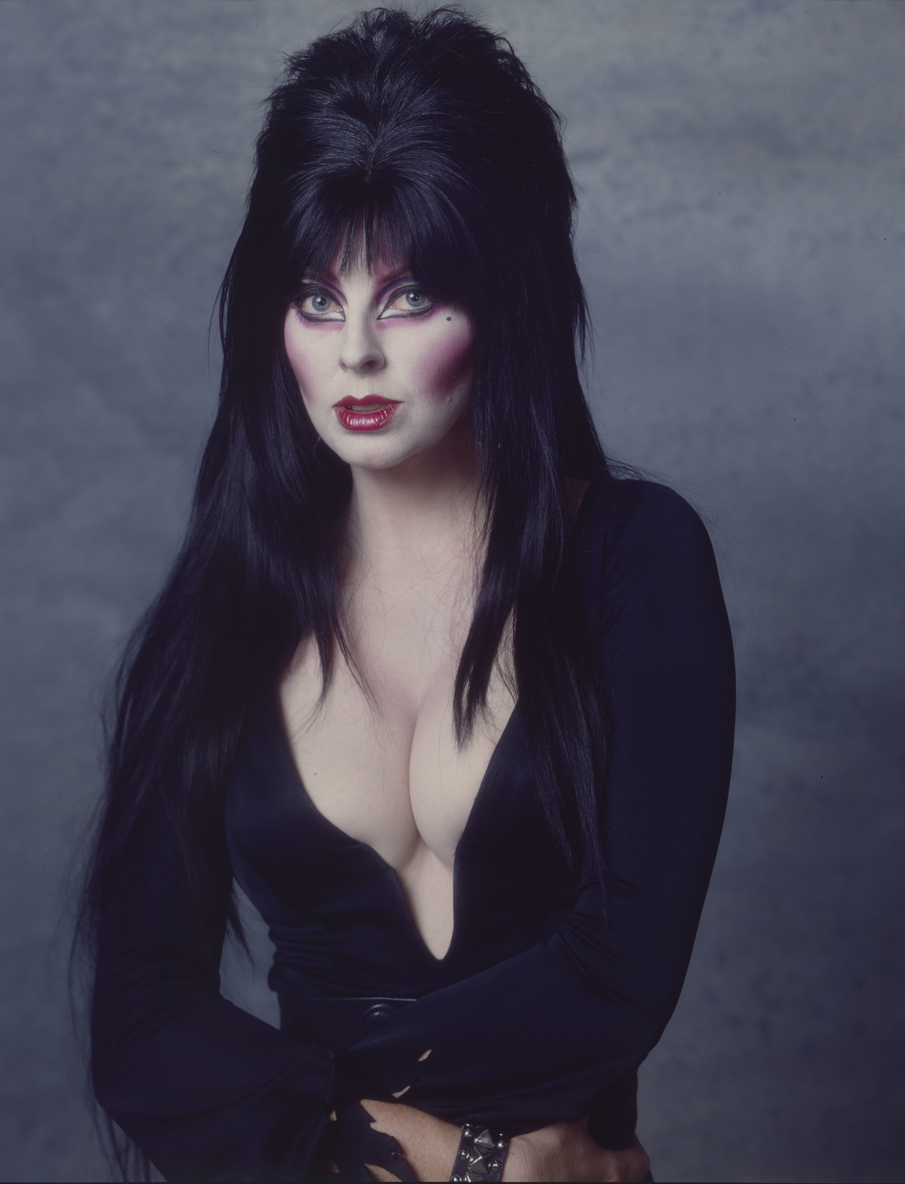 in her dark makeup and campy elvira outfit