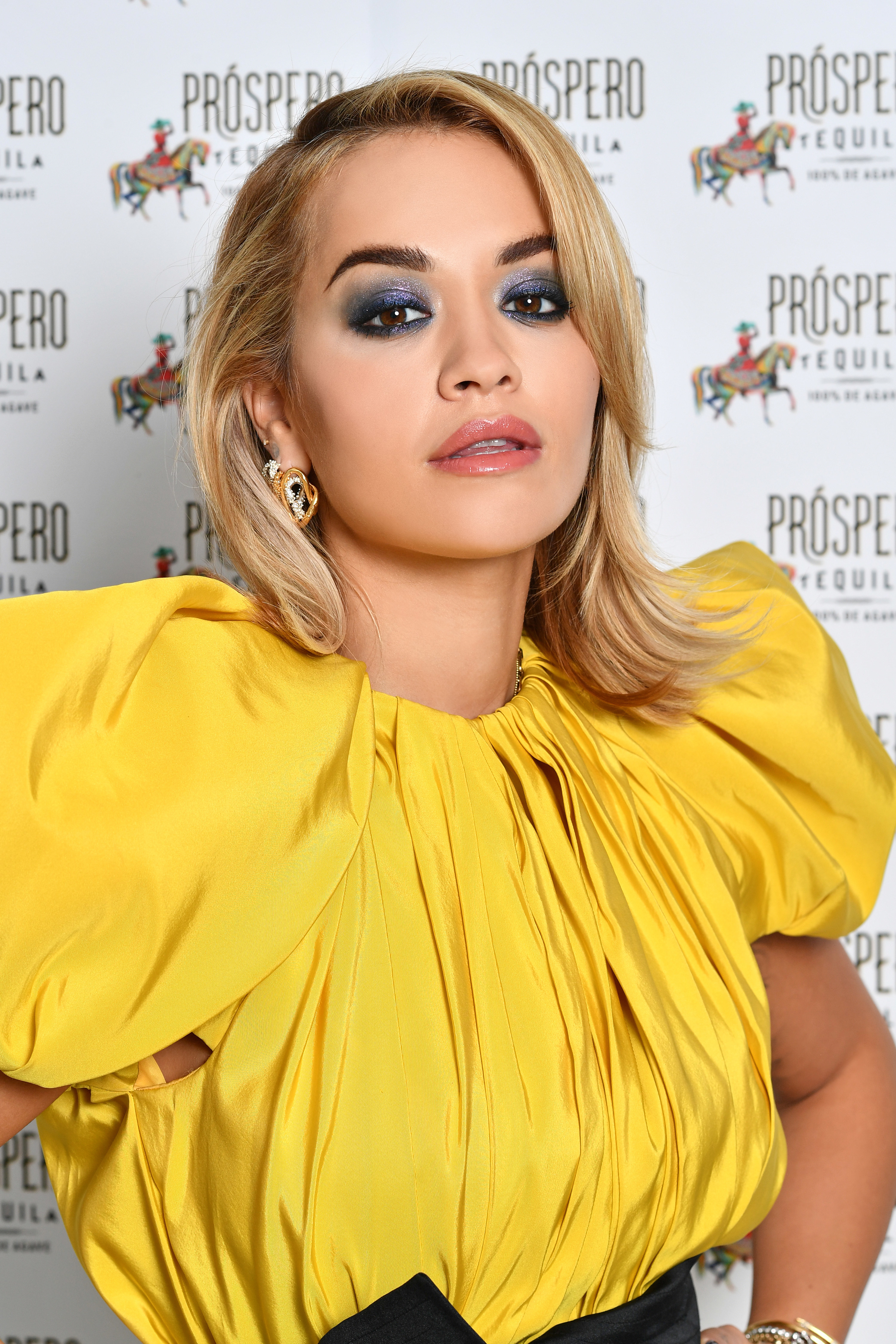 she's in yellow in a red carpet