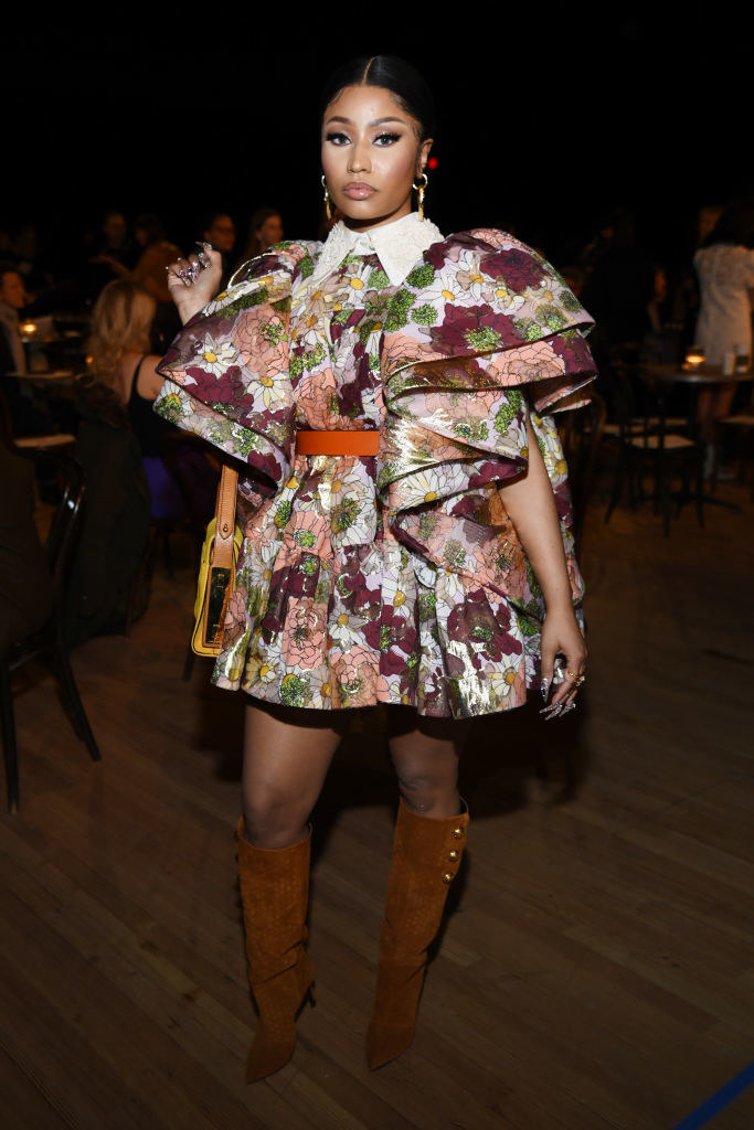 Nicki in a floral dress and suede boots