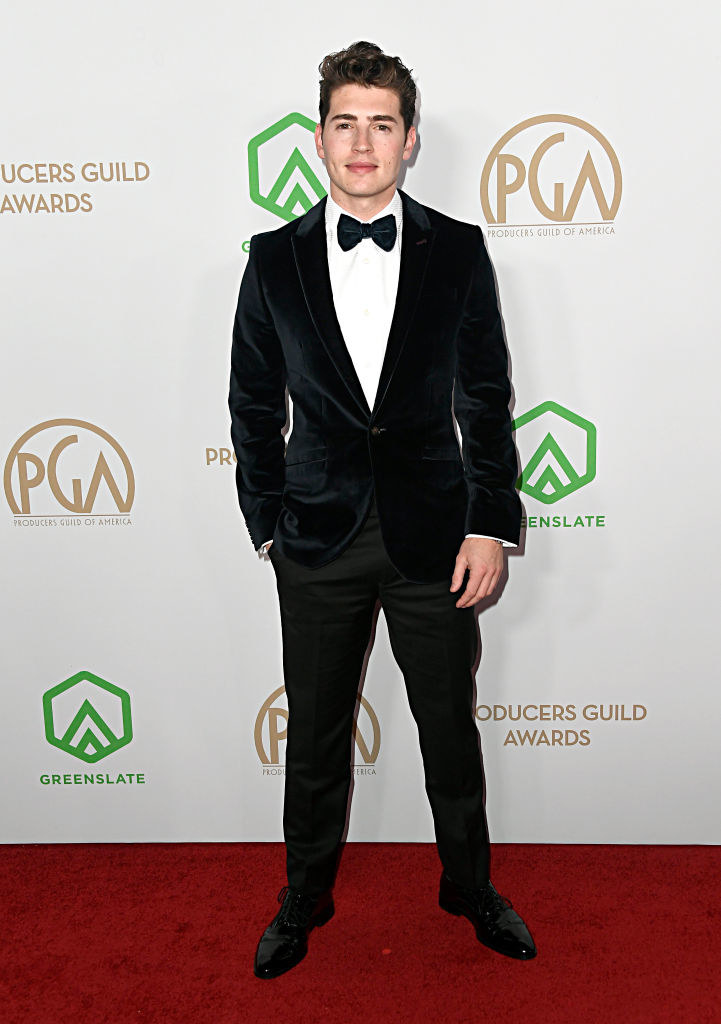Gregg Sulkin in a tuxedo at the Producers Guild Awards