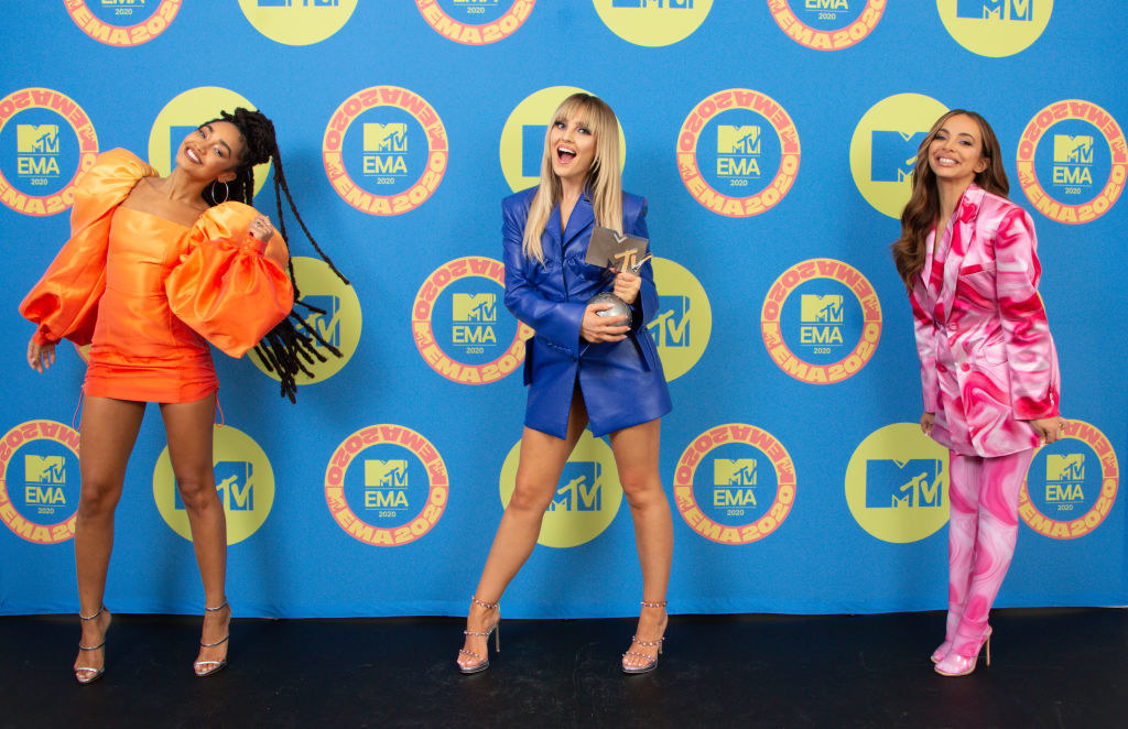 The three members of Little Mix posing with their MTV EMA awards