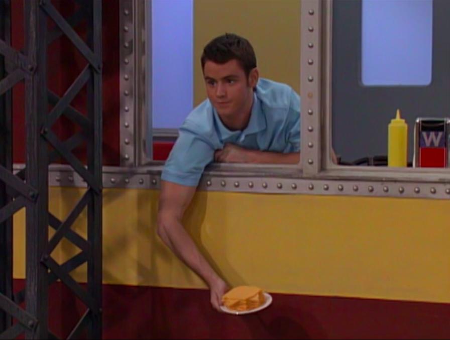 Zeke Beakerman holding a plate of American cheese