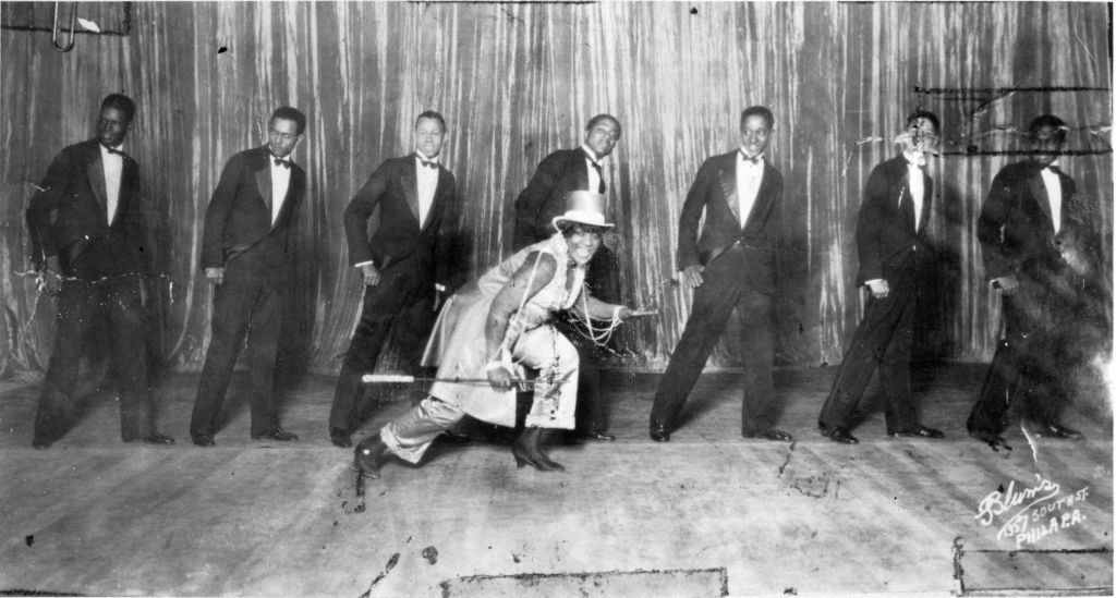 Bessie Smith dancing in front of a line of backup singers