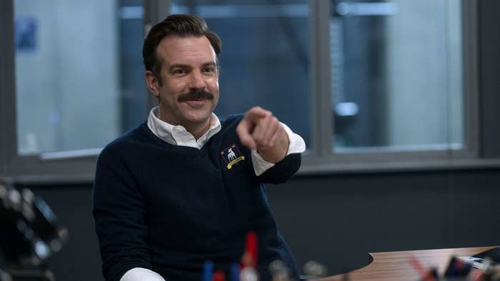 Jason Sudeikis smiling and pointing in Ted Lasso