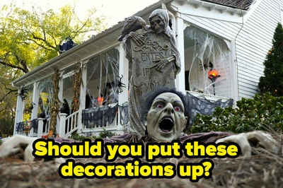 """Spooky decorations are outside of a mansion labeled, """"Should you put these decorations up?"""""""