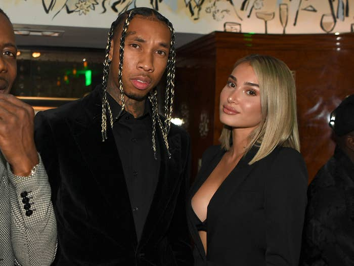 Tyga andCamaryn pose at an event