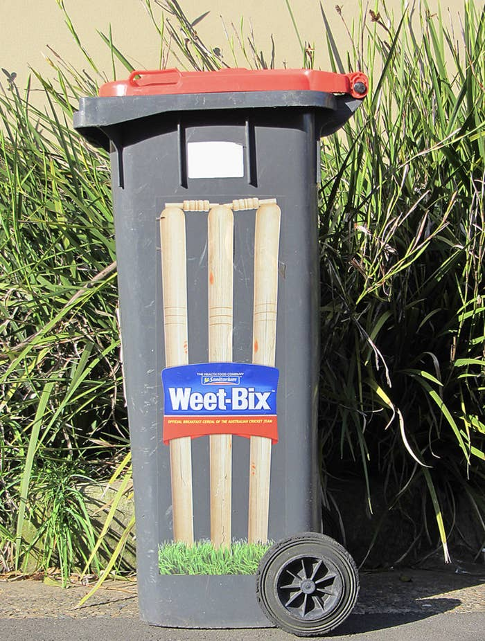 A bin with a sticker on the side that resembles cricket wickets