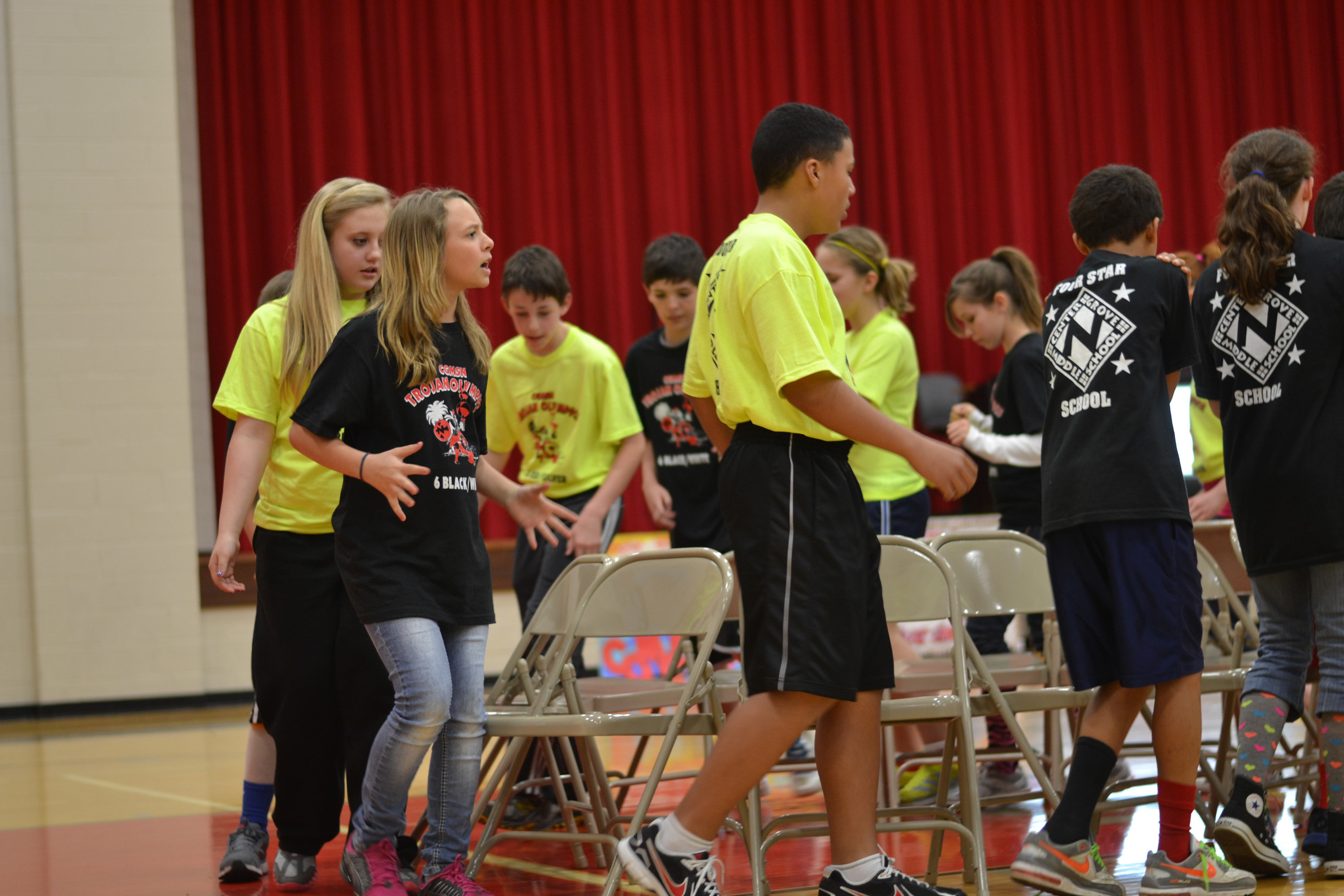 People playing musical chairs