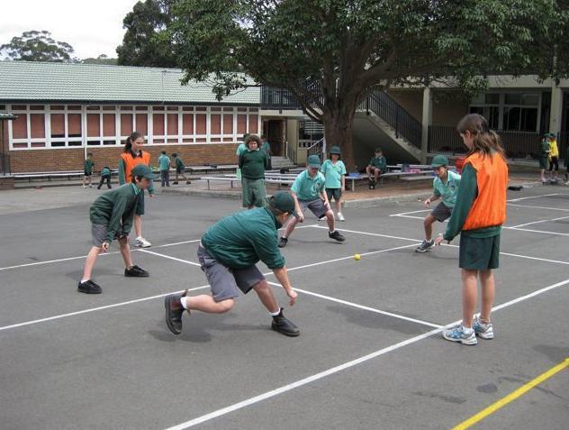 A group of kids playing handball