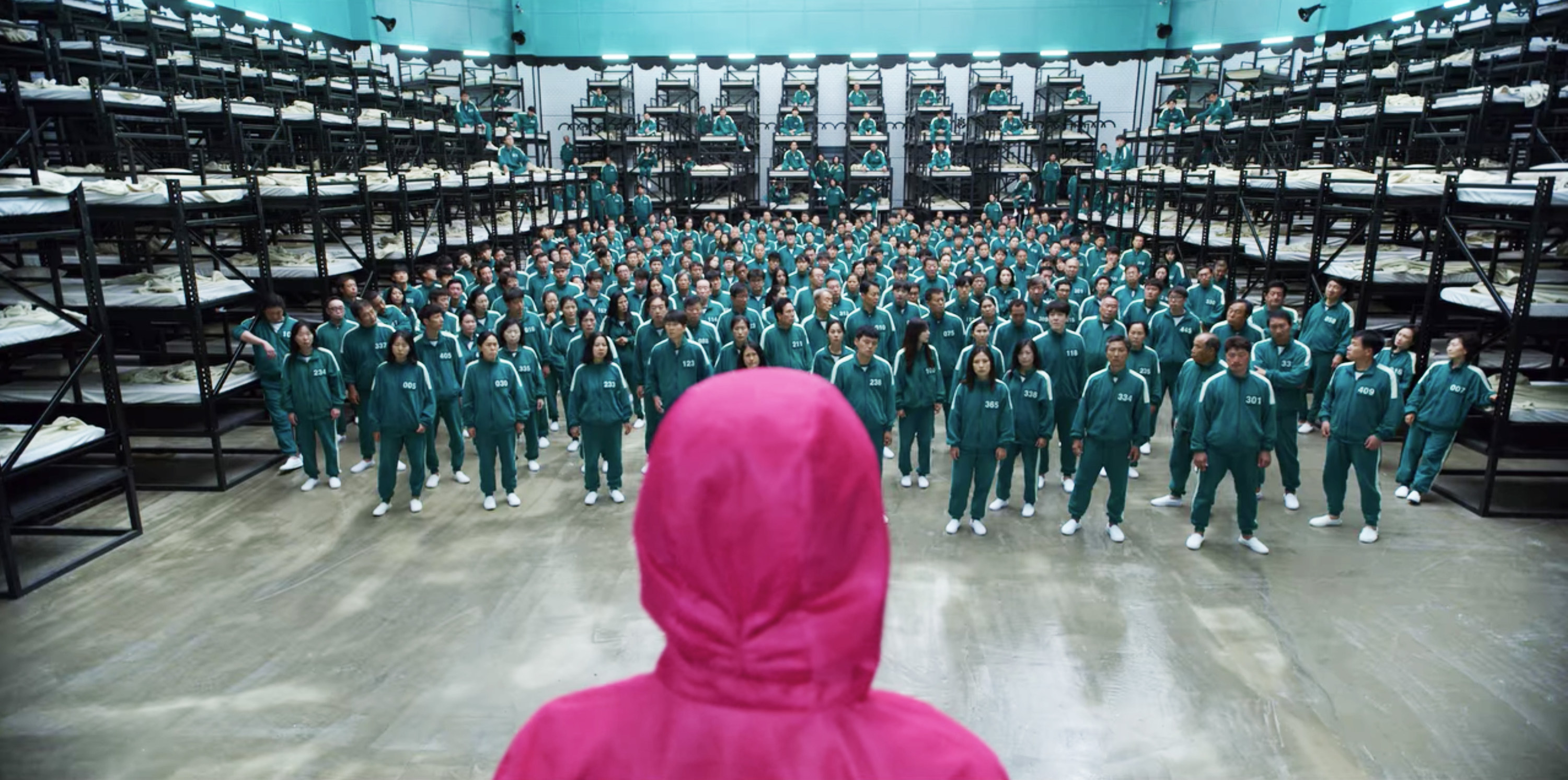 A Squid Game guard looks at the 456 contestants in the dorm room