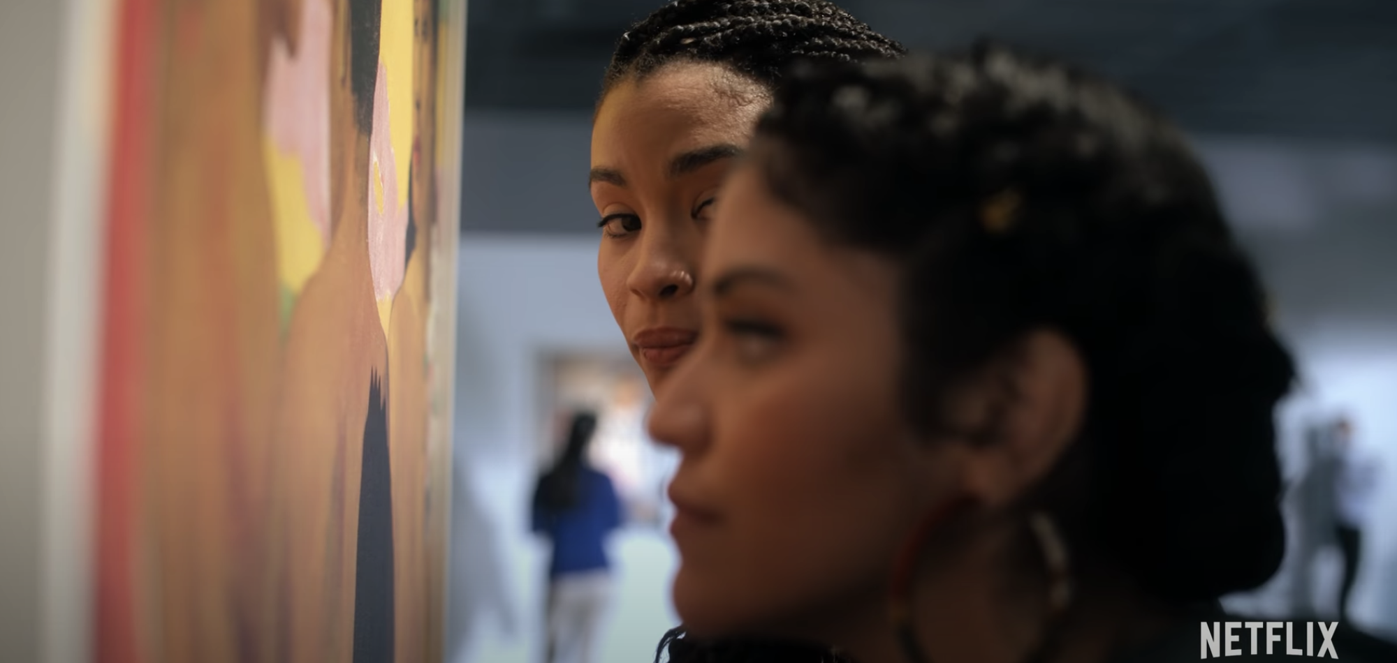Ana staring at Bree as she looks over a piece of art