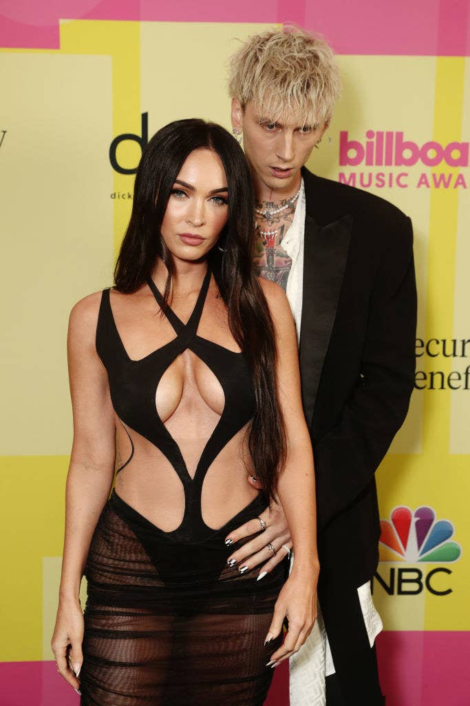 The couple posing together on the red carpet