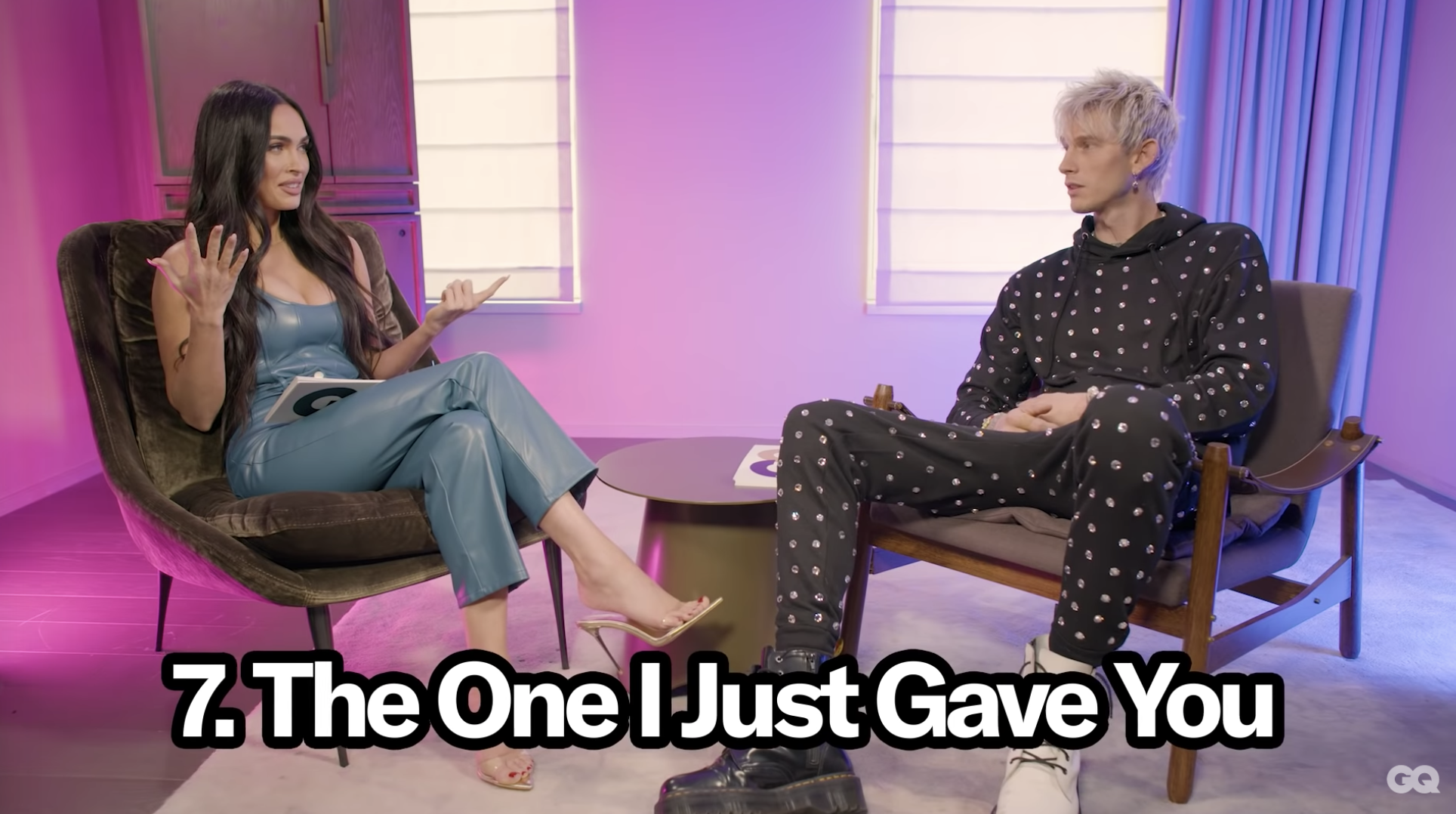 Megan Fox and Machine Gun Kelly sitting across from each other for an interview