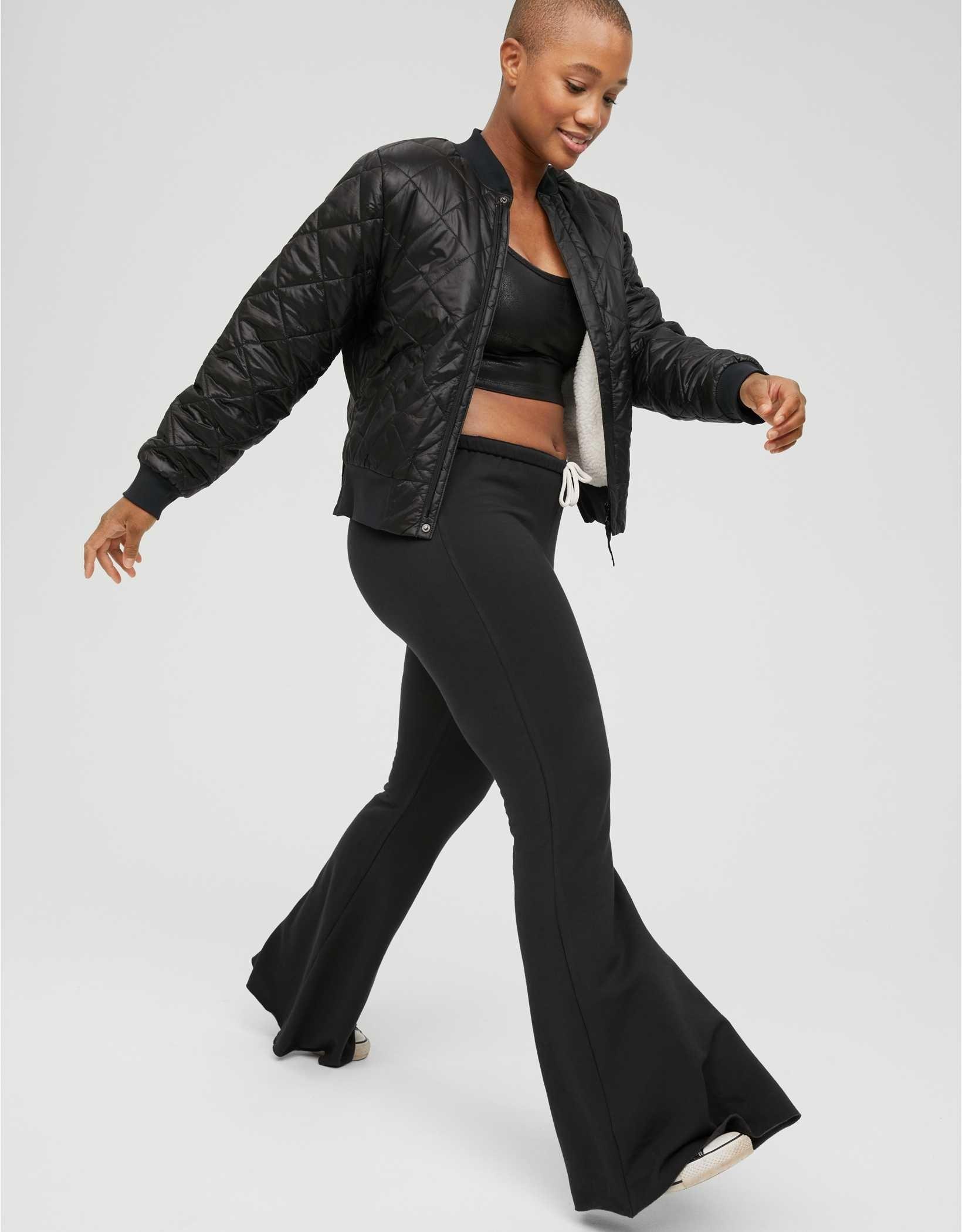 Model strutting in the black flare sweats
