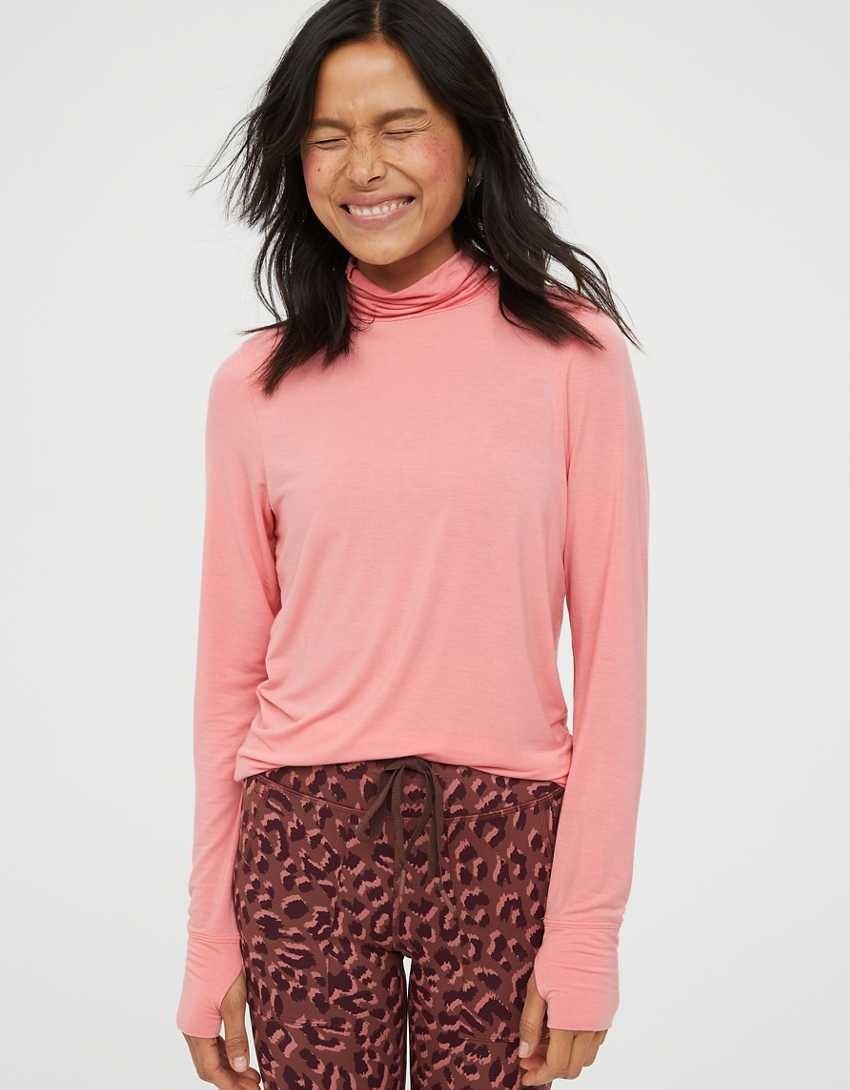 Model wearing the pink turtleneck