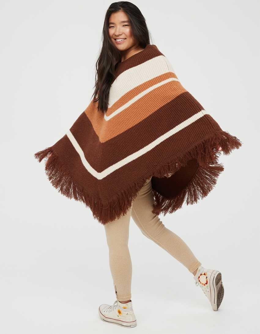 A model twirling in the poncho