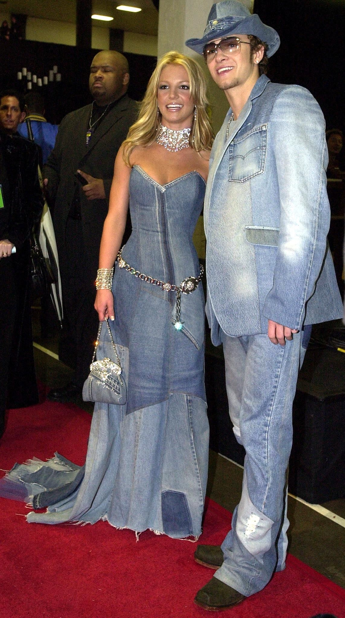 Britney Spears and Justin Timberlake smiling and in denim