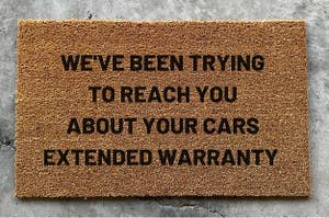 The doormat that reads We've Been Trying to Reach You About Your Cars Extended Warranty
