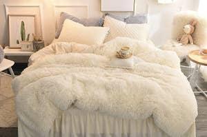 the off white faux fur duvet set on a bed