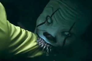Pennywise eating a child's arm