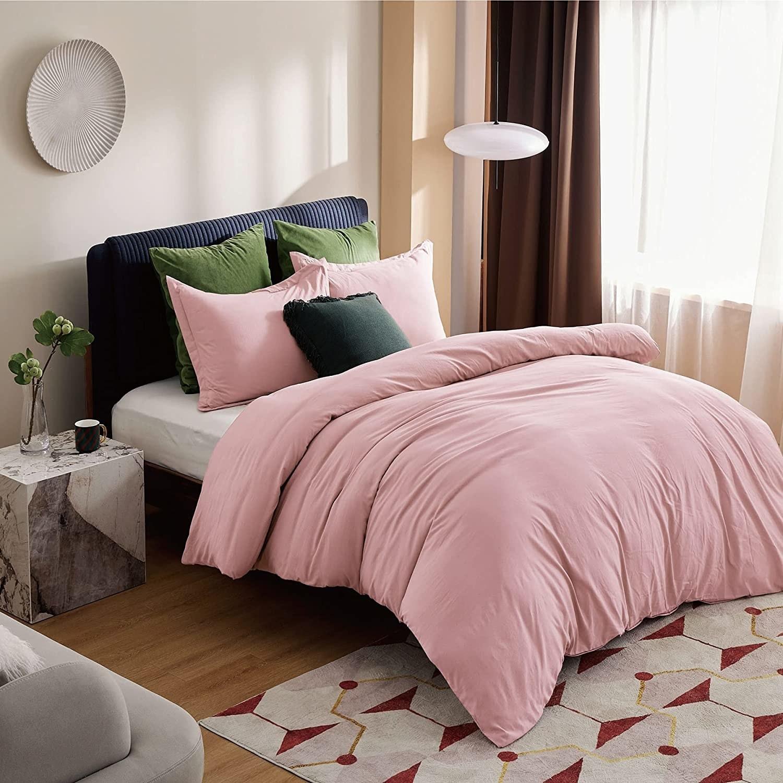 Pink duvet set on bed