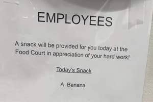 """A sign about how employees get a free banana as a sign of appreciation for their """"hard work"""""""