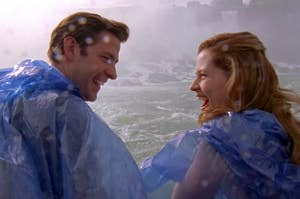 Jim and Pam from The Office smiling at each other as mist from Niagara Falls hits them