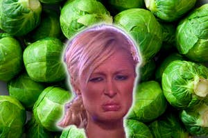 Paris Hilton looking disgusted in front of a background of raw brussels sprouts