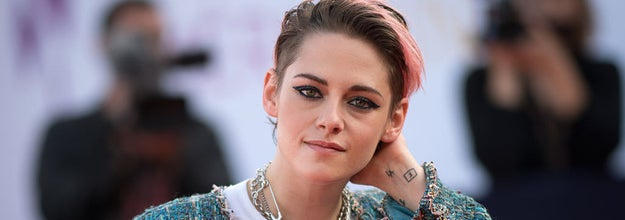 Kristen Stewart poses as she arrives on the red carpet to attend the award ceremony