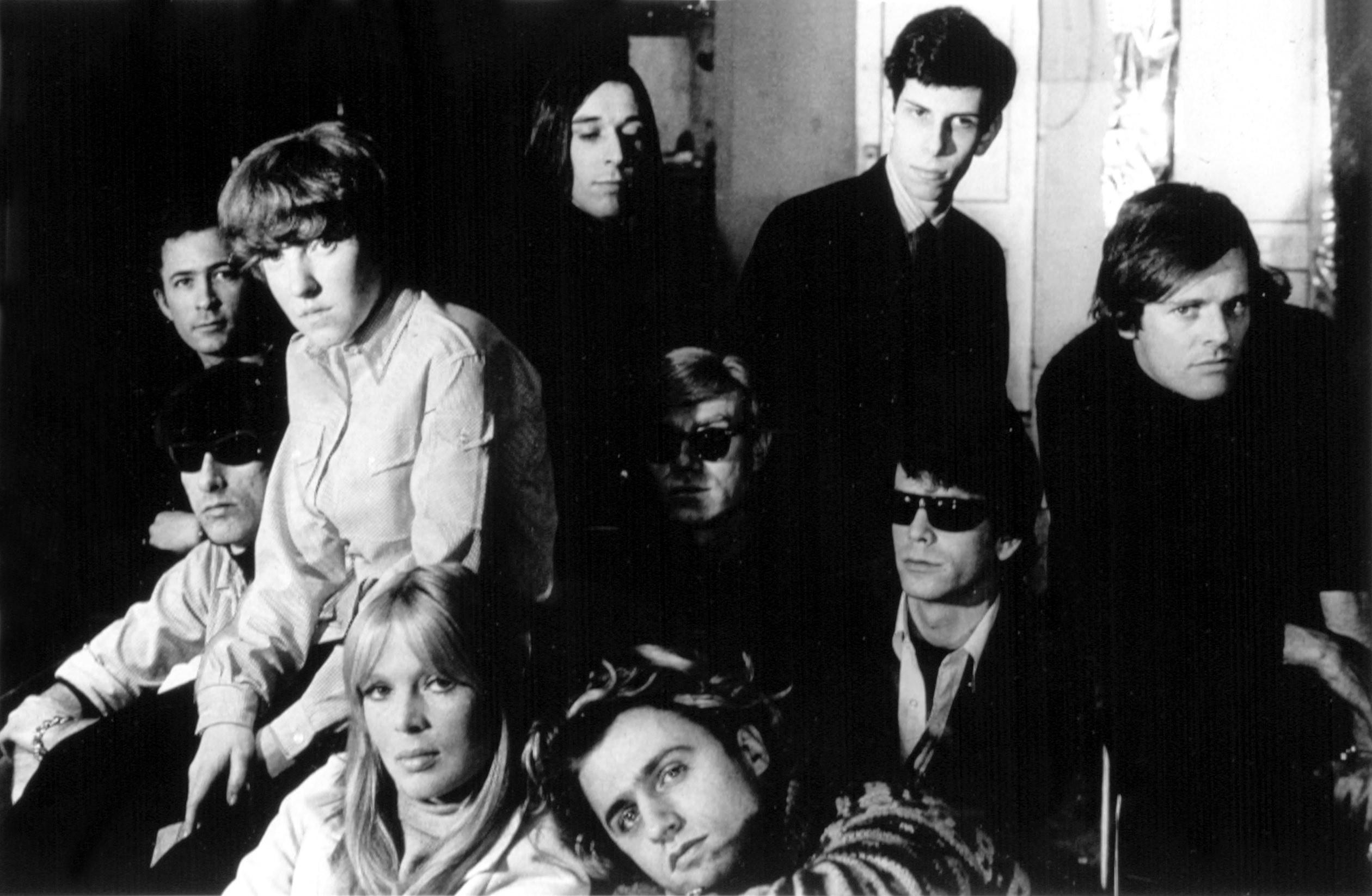 Andy Warhol, Nico, and the Velvet Undergound huddled together
