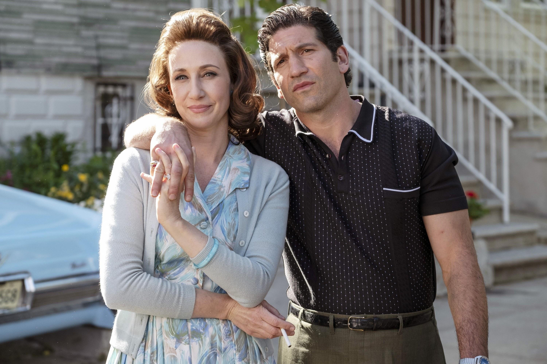 Jon Bernthal puts his arm around Vera Farmiga on the street