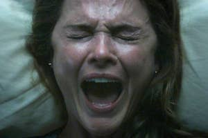 A woman screaming in bed