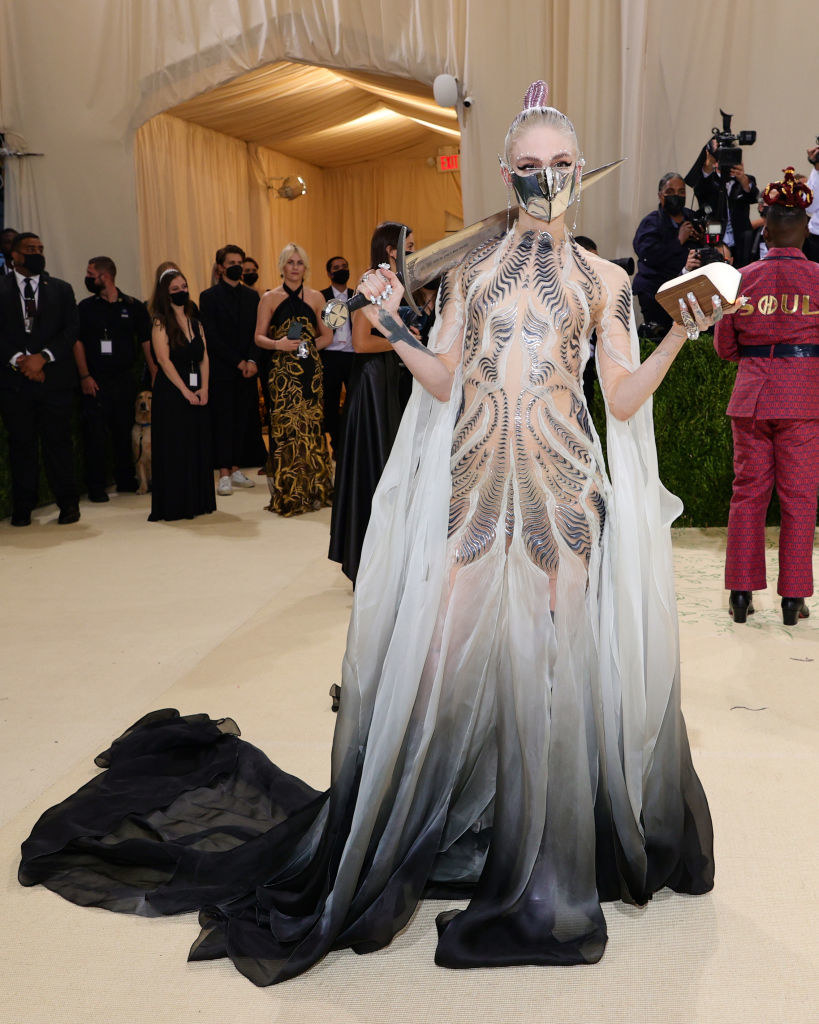 Grimes in an elaborate costume with a mask