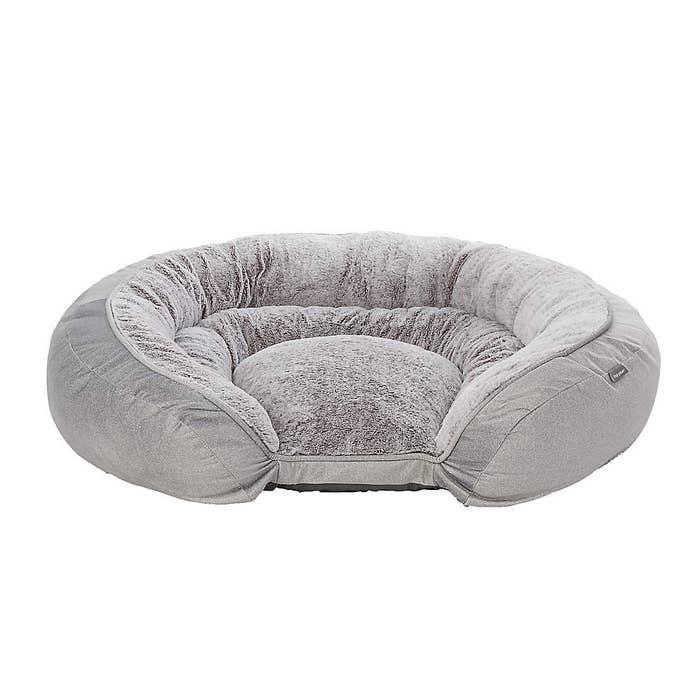 grey fluffy dog bed