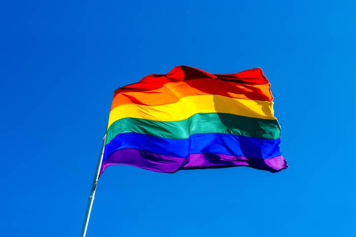 A rainbow pride flag blowing in the wind