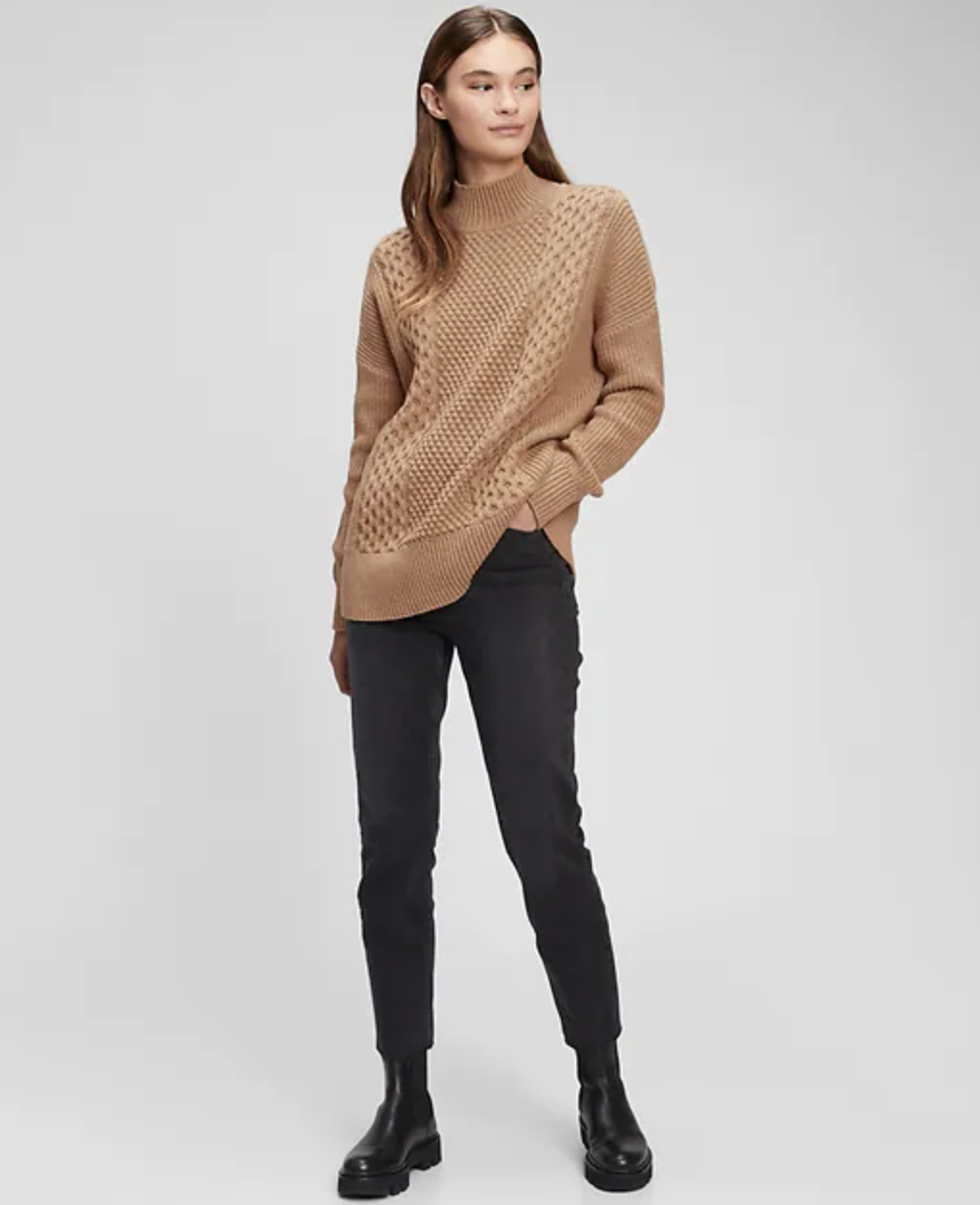 model wearing tan sweater with black pants and boots
