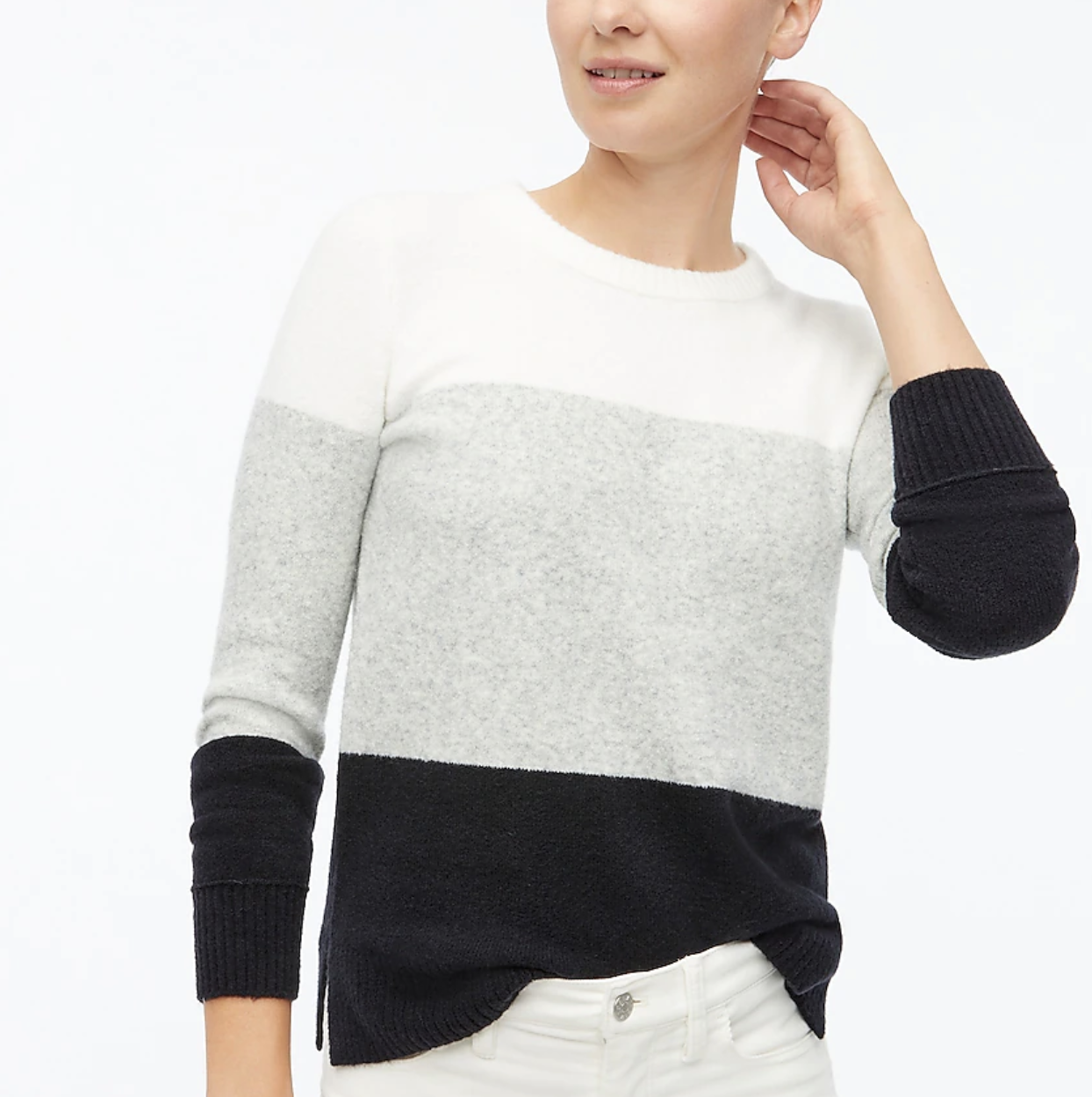 model wearing the gray black and white sweater