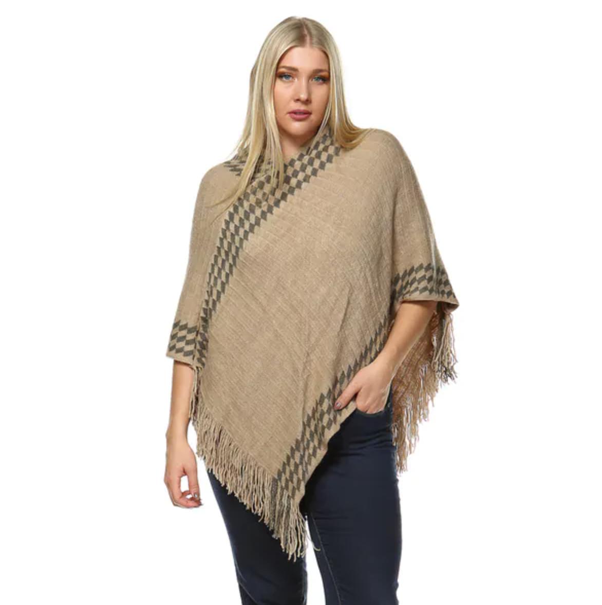 model wearing the poncho in beige
