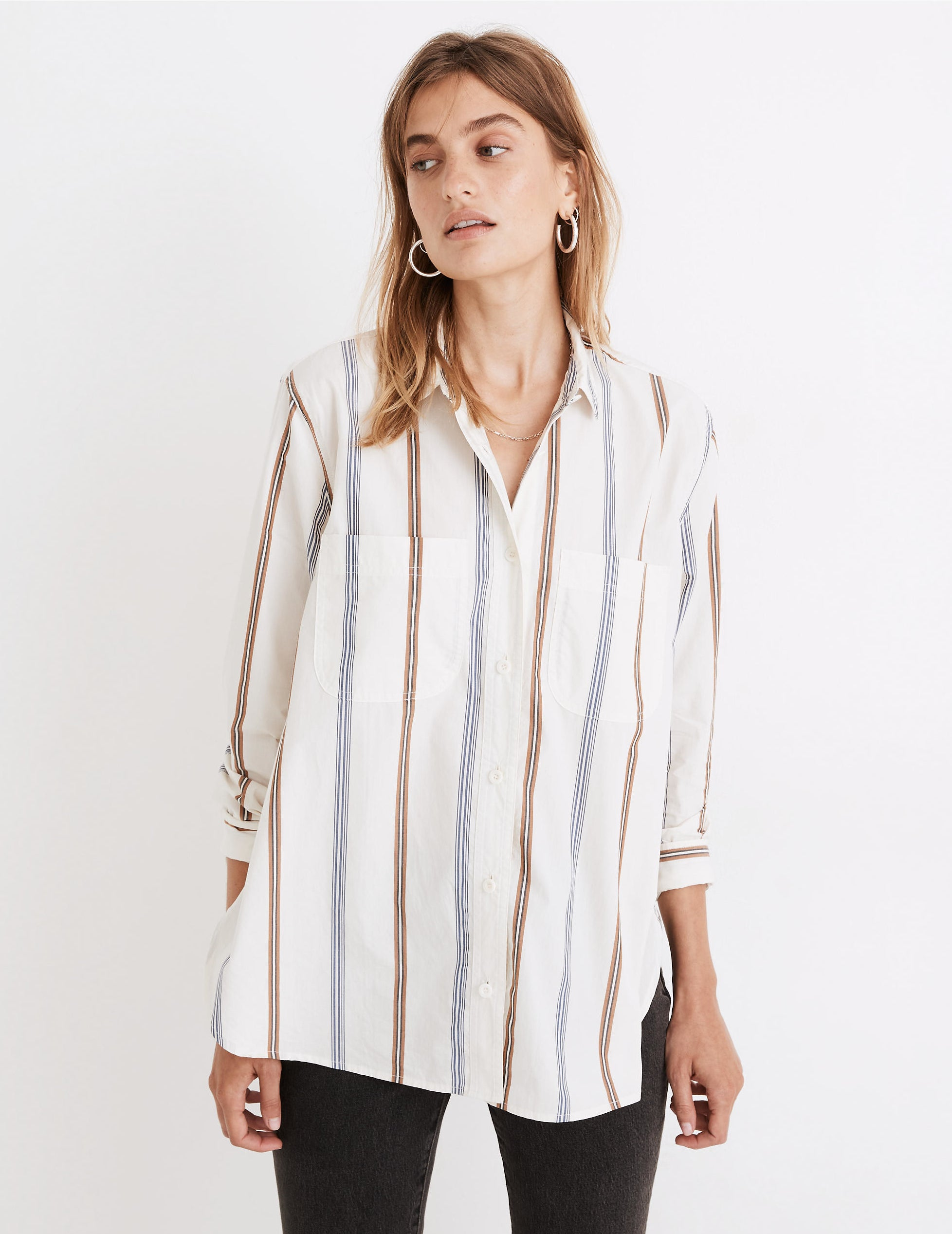 model wearing striped shirt with black pants