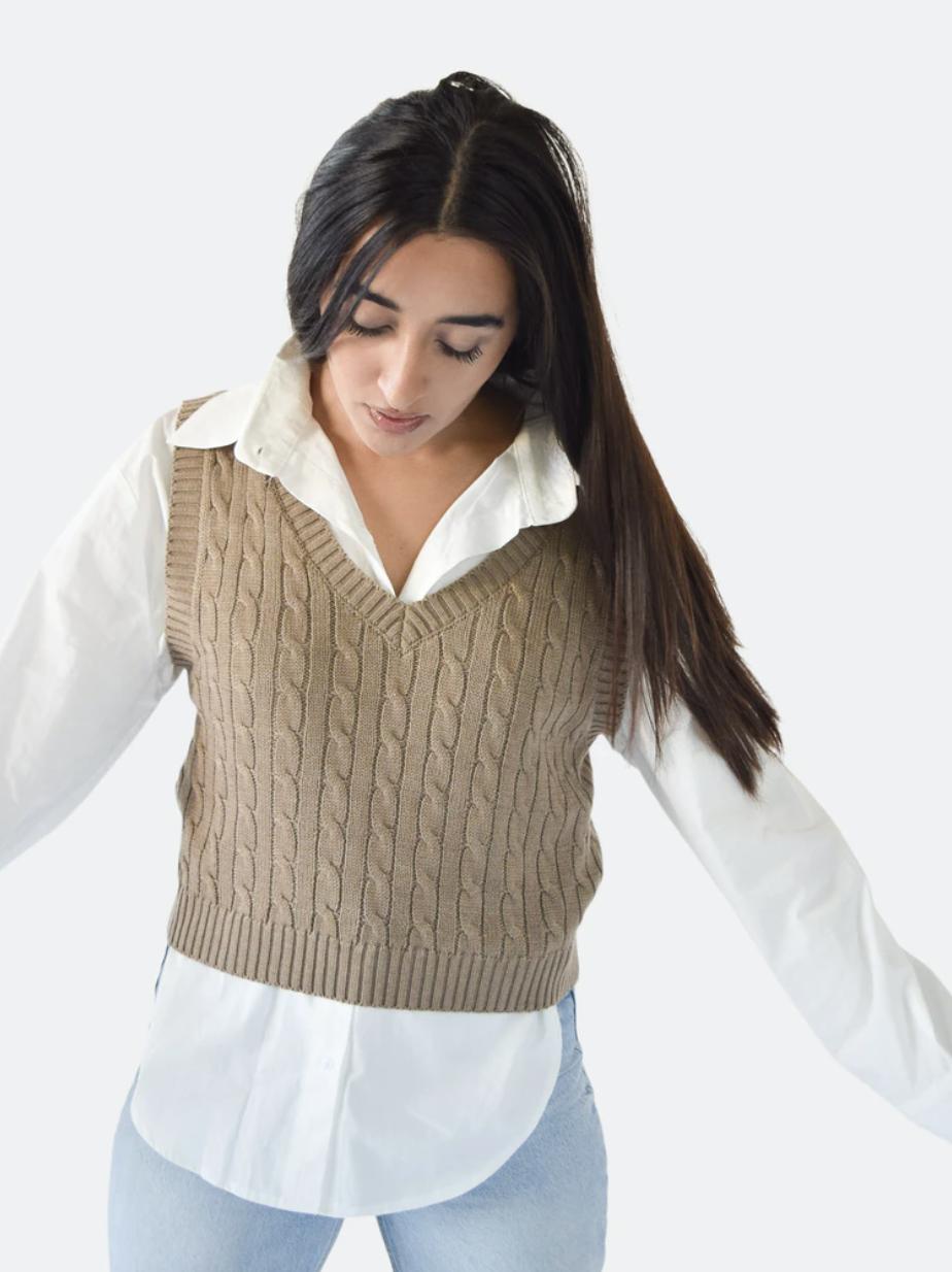 model wearing vest over a white shirt