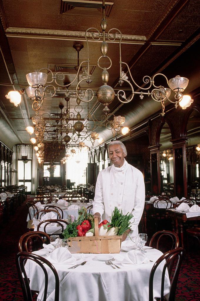 Chef Lewis standing in Gage andTollner restaurant