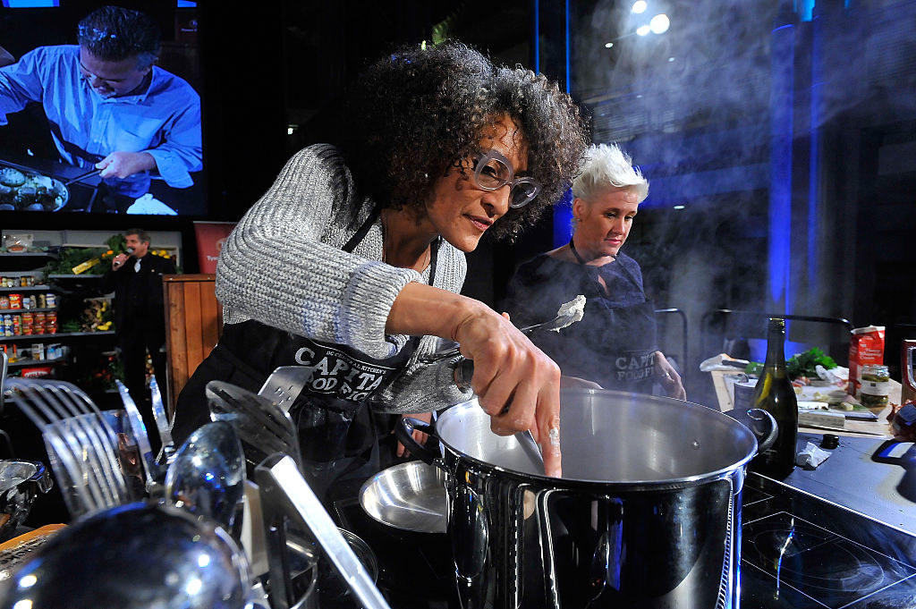 Carla Hall cooking during an event
