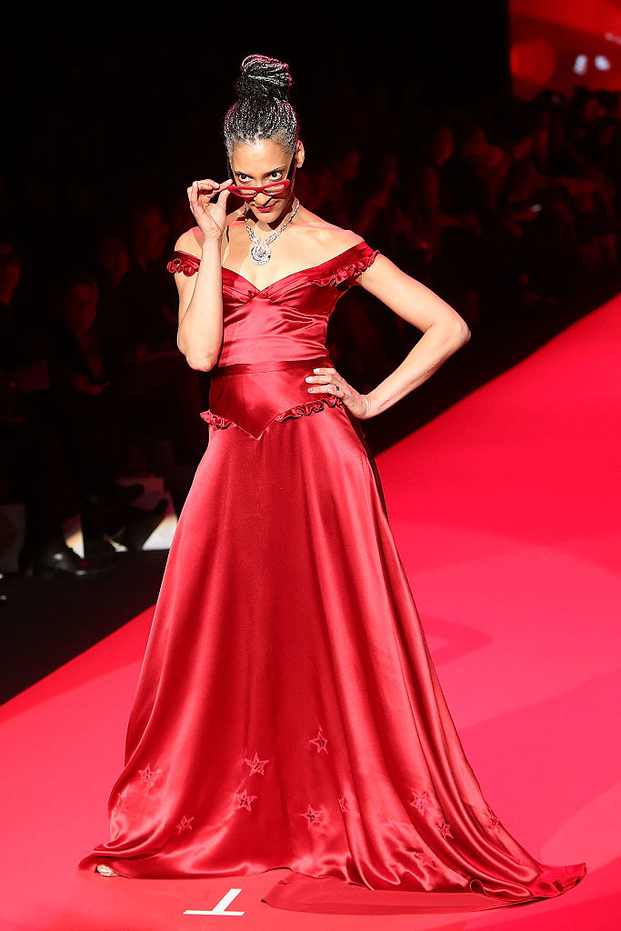 Carla Hall modeling a red gown for a fundraiser