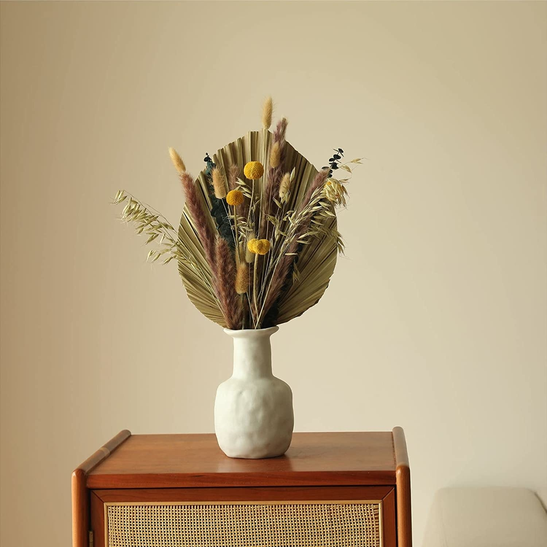 palm leaf bouquet with an assortment of pampas grass stems