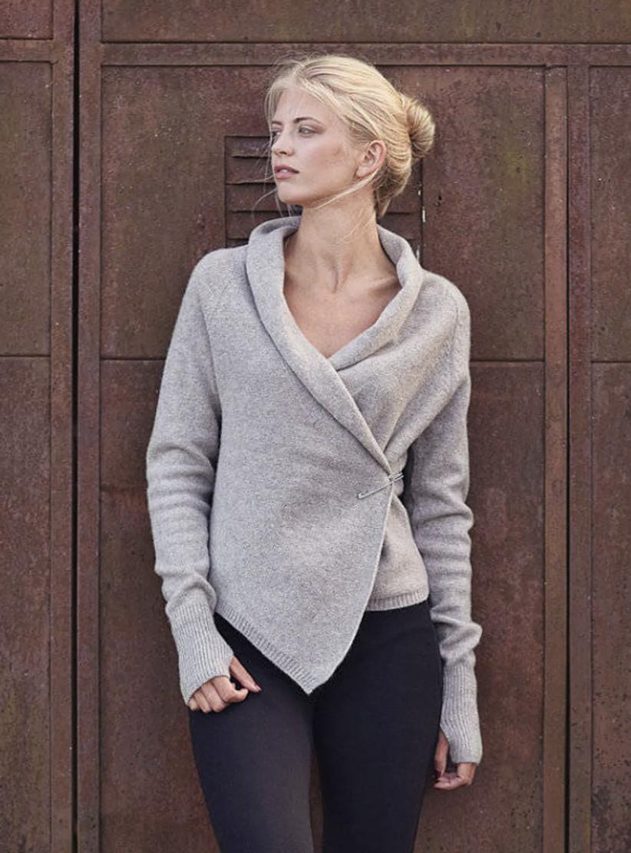 model wearing gray cardigan with black leggings